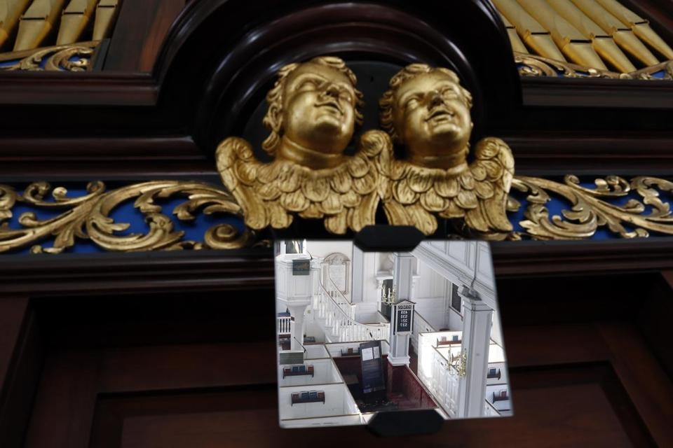 Cherubs look up from the organ console in Old North Church.